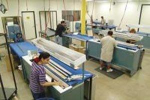 """Varillas de golf y """"Sheet wrapping en fábrica"""""""